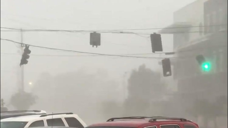 Traffic lights swing back and forth during severe storm