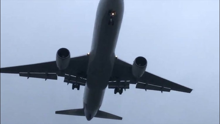 Plane emerges from low clouds on approach to New York