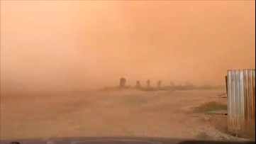 Massive wall of dust sweeps over fields