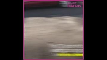 Kid fixes potholes on his street