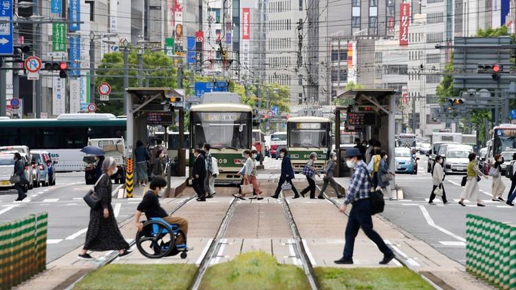 Japan expands virus emergency ahead of Tokyo Olympics