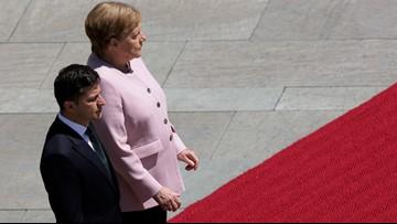 Germany's Angela Merkel says she's OK after shaking at ceremony