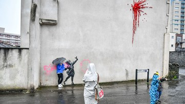 Banksy's Valentine's Day mural covered after it was defaced