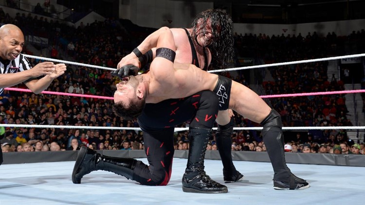 Kane delivers a back-breaker to Finn Balor during a match on Monday Night Raw. Photo courtesy WWE