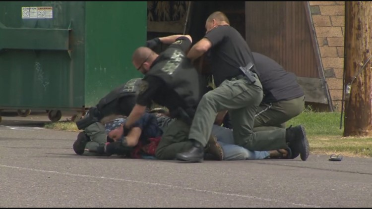 Deputy reassigned as review continues into repeated punching of homeless man