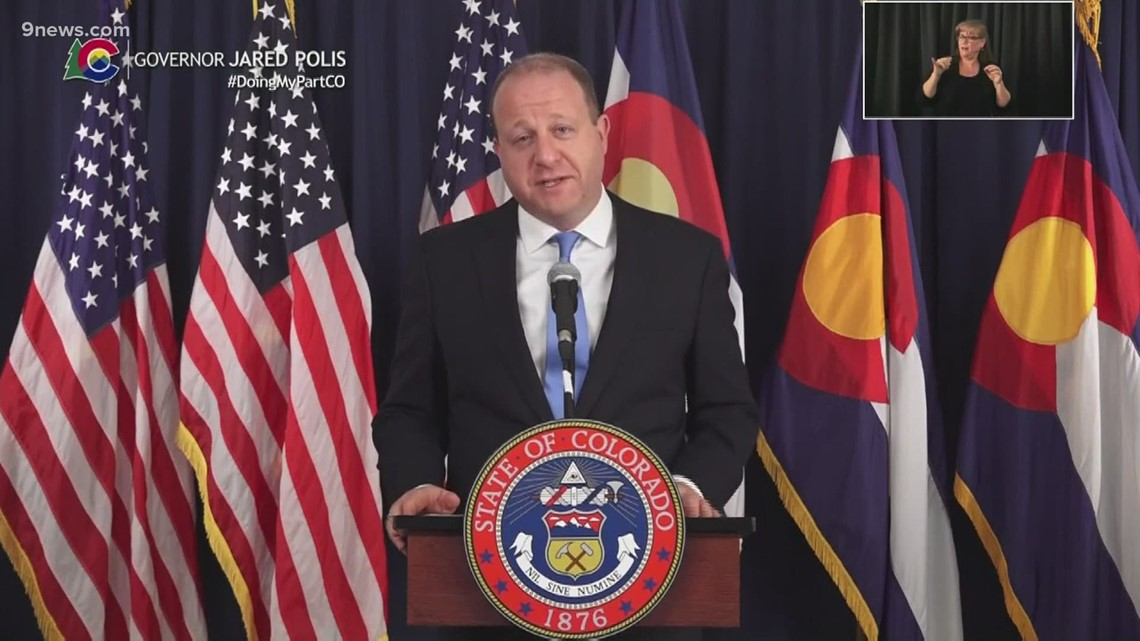 Gov. Polis: We could return to something close to normal this summer