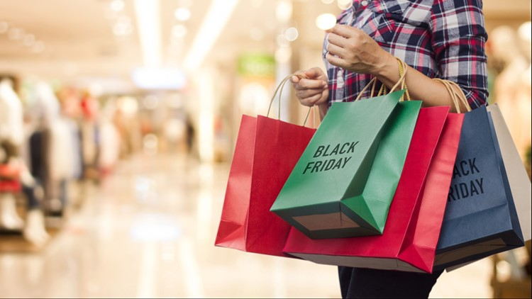 Black Friday, Woman holding many shopping bags while walking in the shopping mall background christmas shopping