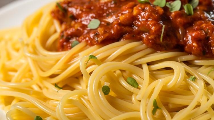 Spaghetti with sauce of Mediterranean tuna, oregano and Italian extra virgin olive oil - focus on spaghetti
