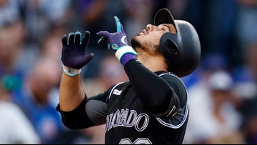 Powerful Rockies rally past Cubs, 9th straight win at home