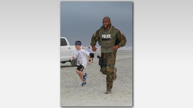 boy runs with police