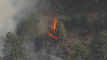 Wildland fire burning west of Golden