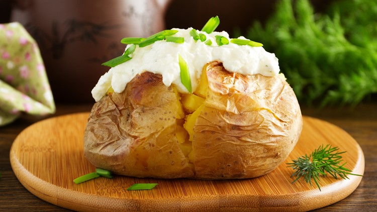 Baked potato with cream of the cream cheese closeup day