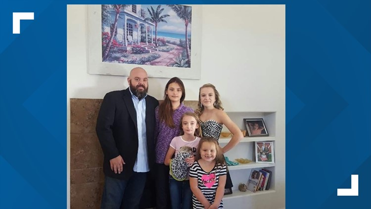 Joseph Kroiss with his four daughters