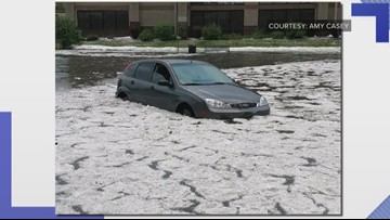 Car gets stuck in flooded intersection Friday