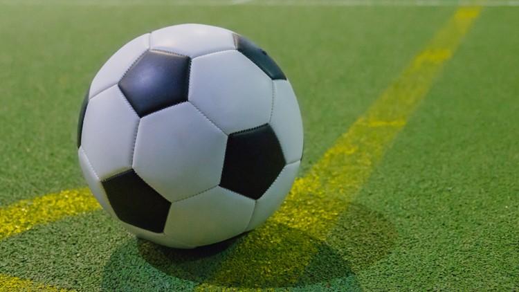 Soccer ball on a corner kick line on an artificial green grass field futsal mini football indoor soccer ball