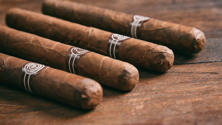 Cuban cigars on wooden background, copy space