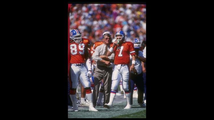 13 Sep 1996  Denver Broncos head coach Dan Reeves confers with quarterback  John Elway during a game against the San Diego Chargers at Mile High  Stadium in ... 573b85b9e