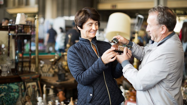 Mature family couple buying antique things at the fleamarket outdoor vintage garage sale indoor flea market antiques