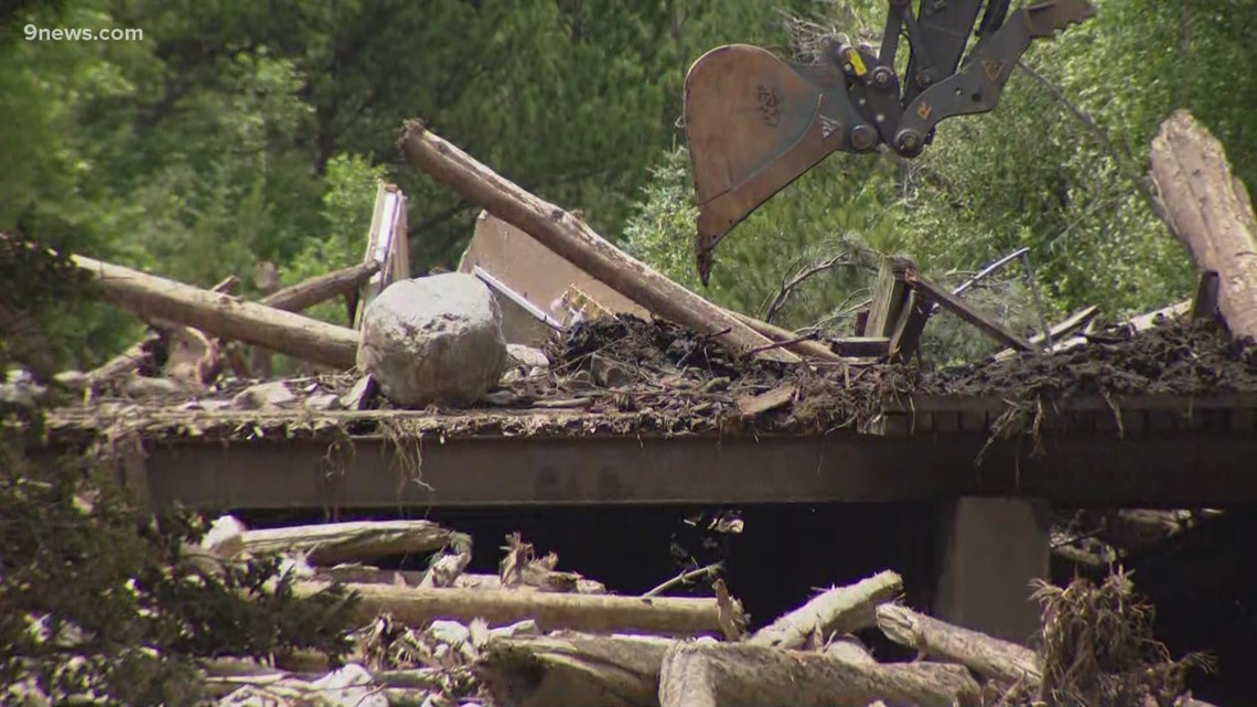 Multiple crews working to  clear piles of debris in Larimer County after flooding
