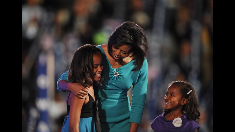 Michelle Obama, wife of Democratic Presidential candidate Barack Obama, brings daughters Malia (L) and Sasha on stage at the Democratic National Convention 2008 at the Pepsi Center in Denver, Colorado, on August 25, 2008.