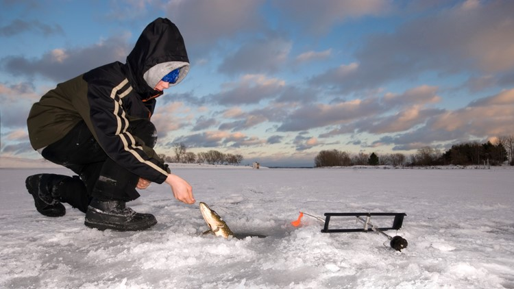 young boy ice fishing