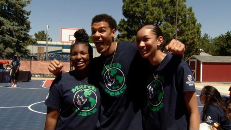 Two teens lead March for Peace along with Broncos' Justin Simmons