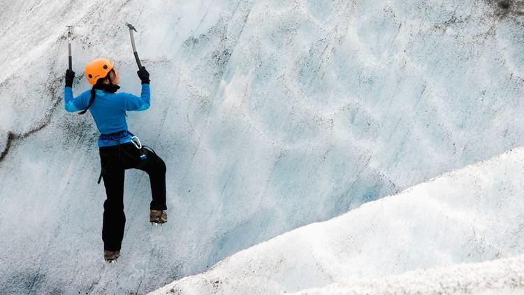Hiker climbing Fallsjokull glacier