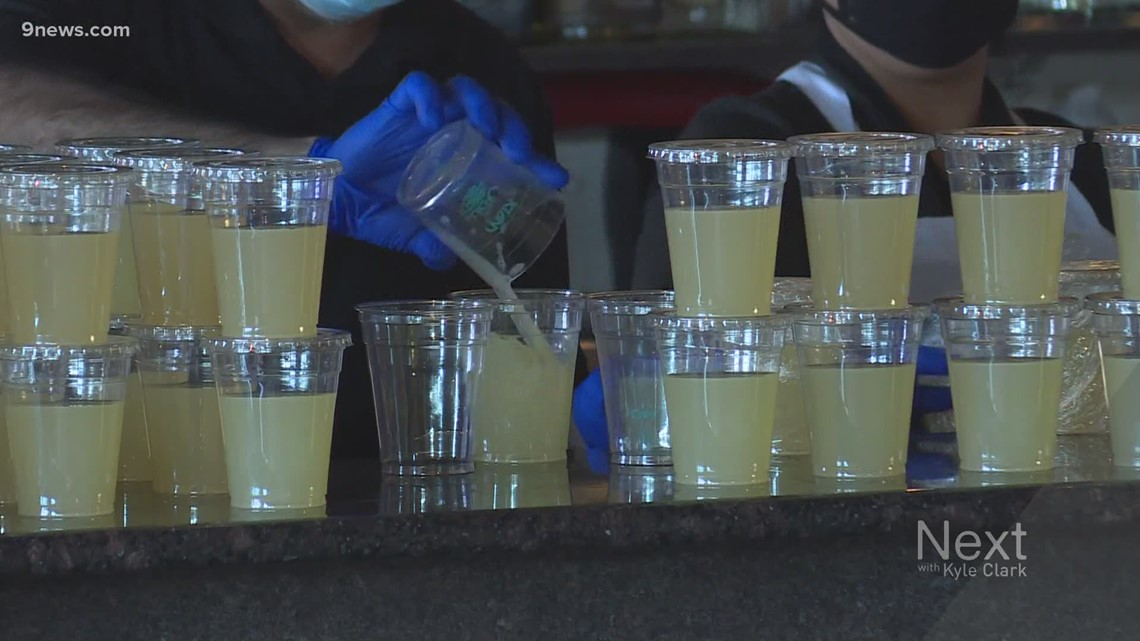 Polis signs bill allowing to-go alcohol to continue in Colorado