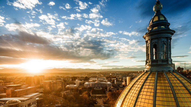 beautiful drone image of the golden cupola of the Colorado state capital building in the city of Denver denver sunset