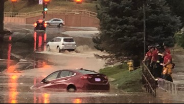 Firefighters rescue people from cars stuck in standing water