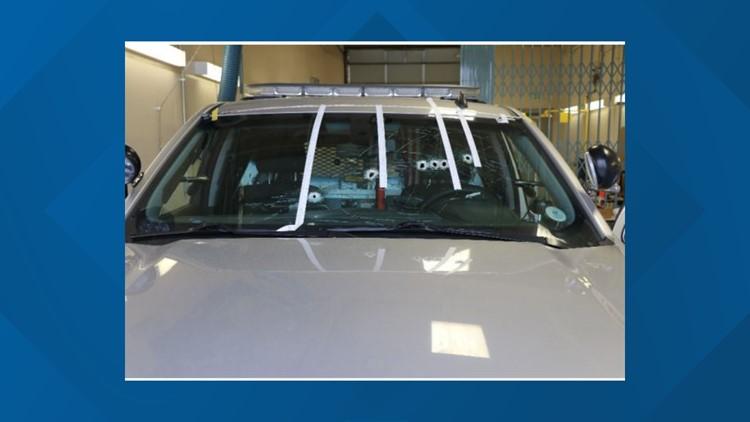 Bullets patrol car