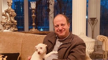 Governor Polis tweets photo with pit bull after veto