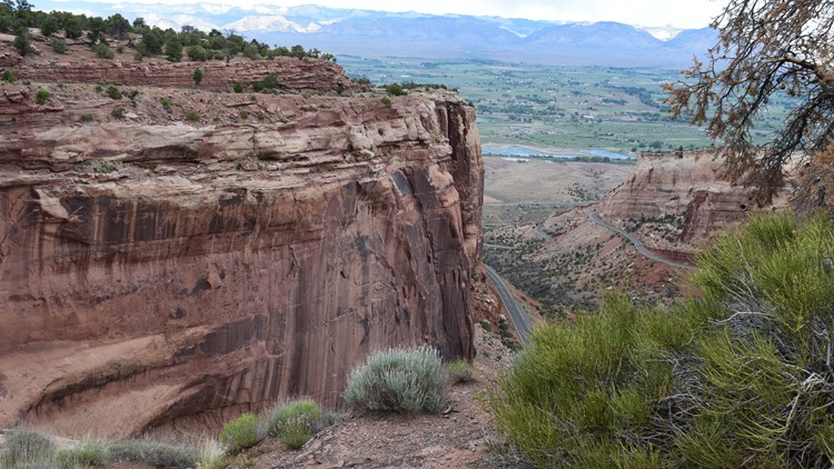Looking out on those massive red cliffs at Colorado National Monument.