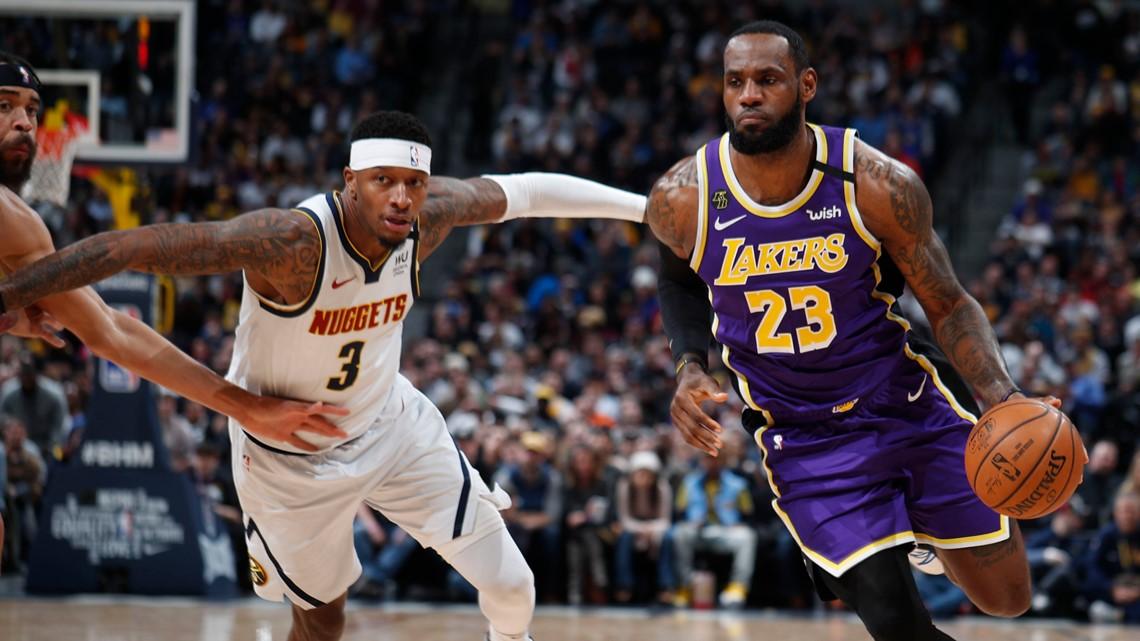 James' triple double, Davis lead Lakers past Nuggets in OT