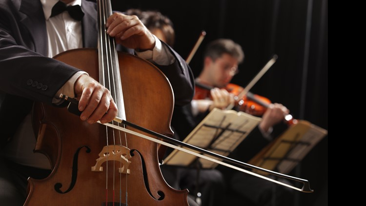 symphony orchestra conductor violins cellos music live
