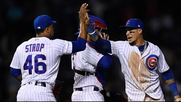 Schwarber, Báez homer; Cubs end Rockies' winning streak