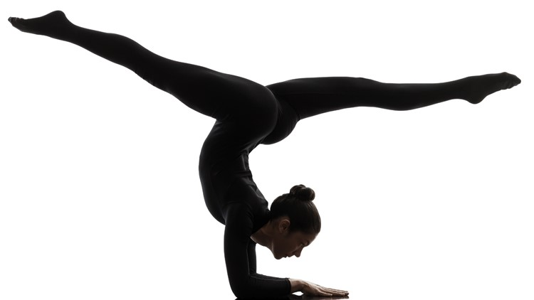 one  woman contortionist practicing gymnastic yoga in silhouette on white background acrobats