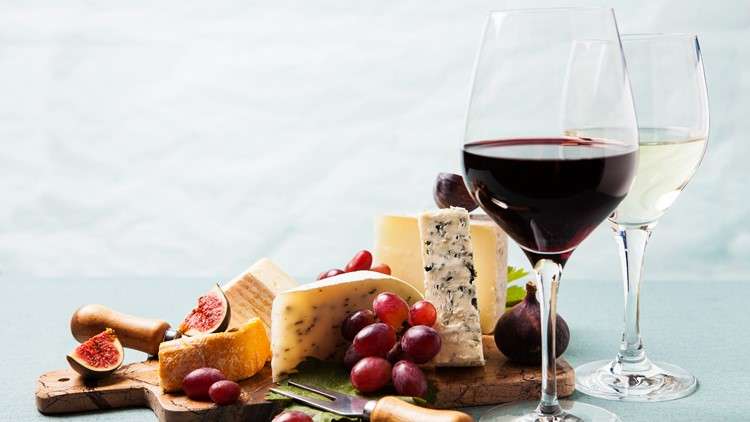 Cheese board: variety of cheeses on marble serving board wine festival
