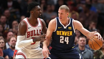 Murray, Jokic lead Nuggets to 135-105 rout of Bulls