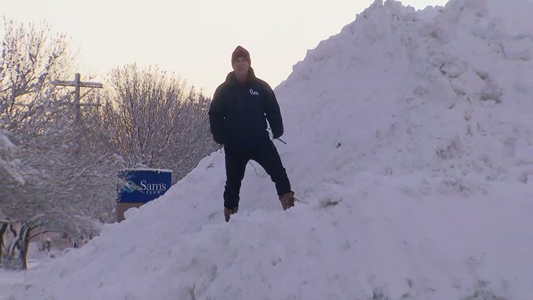 Snow piled up as Colorado digs out from storm
