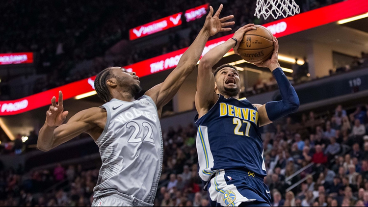 Jimmy Butler scored 31 points, Karl-Anthony Towns had 26 points and 14 rebounds and the Minnesota Timberwolves ended the NBA's longest-running playoff drought, beating the Denver Nuggets 112-106 in overtime Wednesday night in the first final-day play-in game in the league in 21 years.