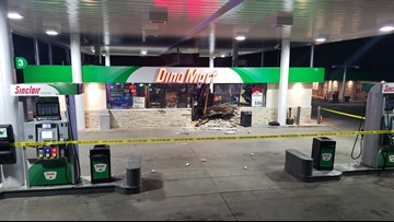 Man arrested after police say he drove vehicle into gas station, bank in Littleton