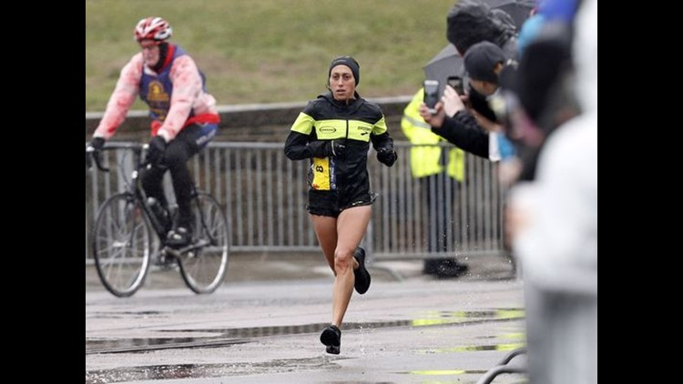 The two-time U.S. Olympian, who trains in Michigan, finished in an unofficial time of 2:39:54 in a heavy rain