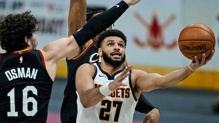 Murray's 50 points power Nuggets past crumbling Cavaliers