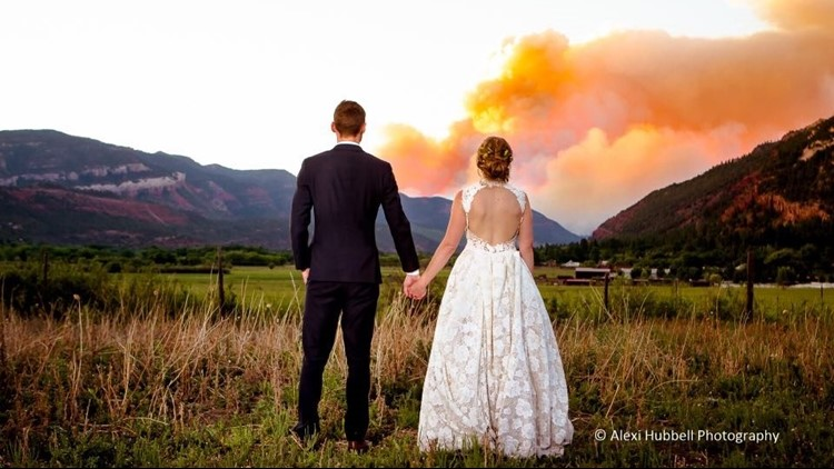 The couple and photographer have put out the photo to try and remind people that southwest Colorado is much more than just the 416 Fire - and to ask for donations for the area.