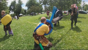 Yes, those are people fighting in medieval garb in parks across Colorado