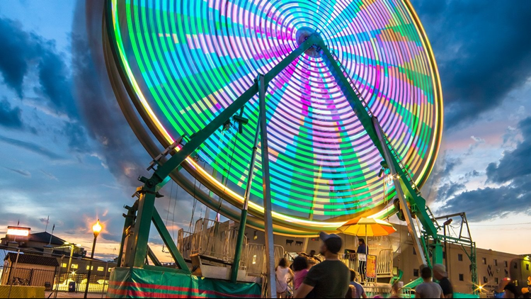 Denver County Fair near color ferris wheel