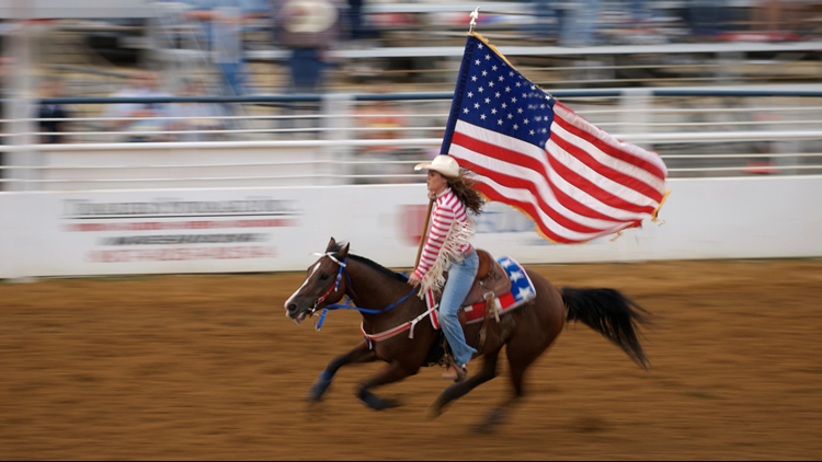 state fair cowgirl american flag distance