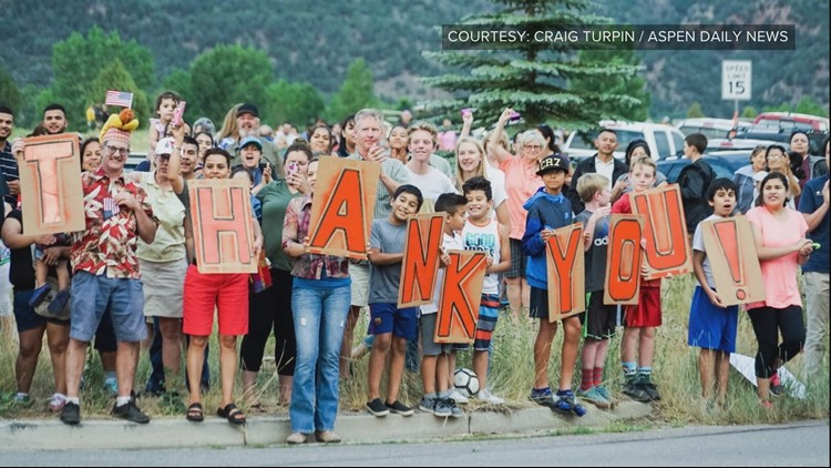 Firefighters battling the Lake Christine Fire arrived back at camp Tuesday night to find hundreds of people ready to thank them.