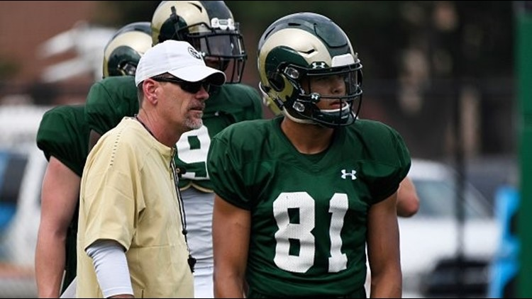 CSU head coach Mike Bobo works with senior wide receiver Olabisi Johnson during fall camp.